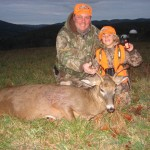Jody Posing with his son Joey and his first buck